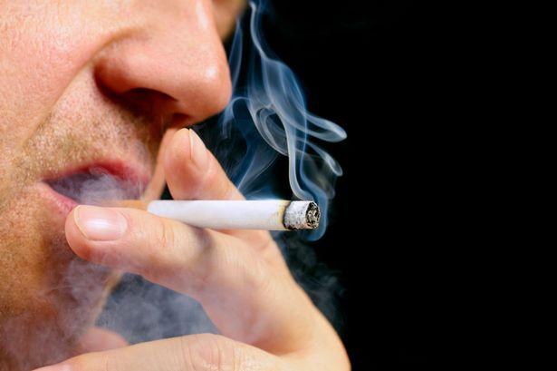 PROD-Senior-male-smoking-cigarette-on-black-background-1.jpg